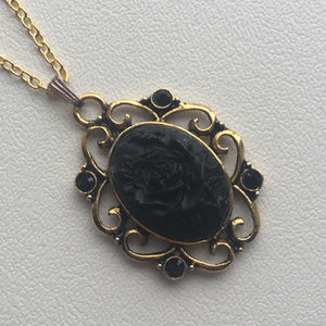Jewelry - Black rose cameo pendant in bejeweled setting